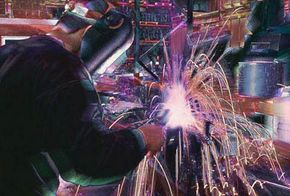 A welder wielding his trademark tool. See more power tools.