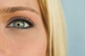 Blue eyes look best when they're accented with mauve and brown shadows in the crease of the eye and gold and orange shadows on the lower lid.