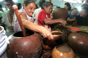 Local women distribute tiste, a drink made from rice and cocoa, in Nicoya, Costa Rica.