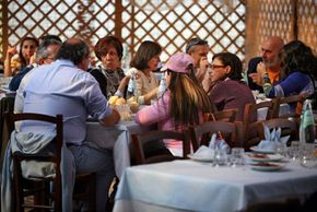 A fish farm in Sardinia, Italy, where diners enjoy a midday meal on a Sunday, has been in the same location since the fifteenth century.
