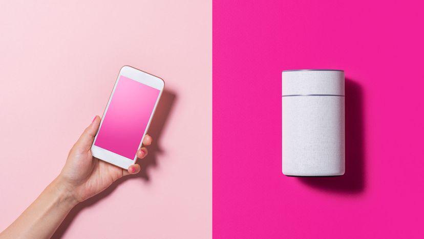 smartphone and smart speaker on pink background