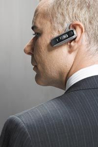 Person with Bluetooth earpiece in ear