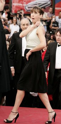 Actress Sophie Marceau begins to blush from embarrassment after a wardrobe mishap at the Cannes Film Festival in 2005. See more emotion pictures.