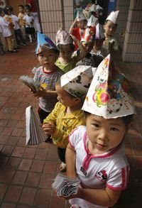 Embarrassment and the propensity to blush appear to develop around kindergarten age -- as these children in Nanjing, China, are discovering -- the time when we begin to grow conscious of others' feeling and thoughts.