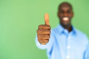 A smile. A thumbs up signal. Is this guy telling you everything's A-OK?