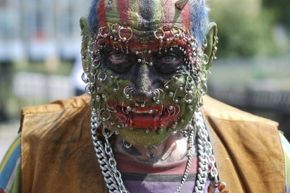 We're not sure if this guy is addicted to body modifications, but it sure seems like he loves them.