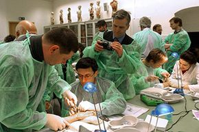 Hand surgeons practice the newest plastic surgery techniques on cadaver hands during a workshop at the Institute of Anatomy, Friedrich Schiller University in Germany.