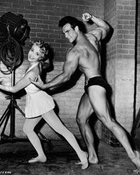 """Jane Powell as Athena Mulvain dances with Steve Reeves as Ed Perkins in the film """"Athena"""" in 1954."""