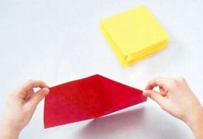 Form each sheet of colored paper into a square and press the folds flat.