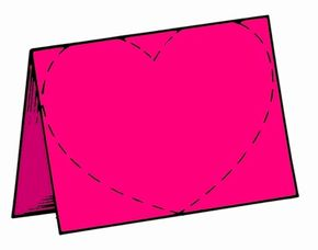 Draw a heart on a folded piece of construction paper and cut it out.