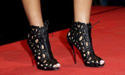 Rihanna's caged booties match several trends with their shape, peep toe and scrolling cutouts.