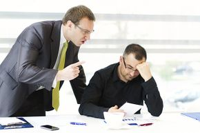 Invading your employee's space to berate him is just not good boss etiquette.