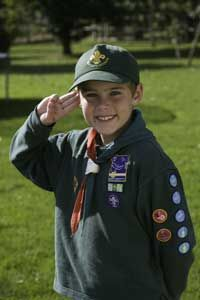 This uniformed Cub Scout salutes the camera.
