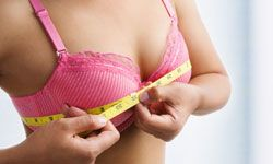 Put down that tape measure. Having large breasts doesn't mean a greater risk of breast cancer.
