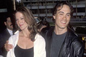 Actor Brandon Lee and girlfriend Eliza Hutton attend a Los Angeles film premiere in 1992.