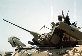 M2 Bradley Fighting Vehicle with its 25mm cannon elevated