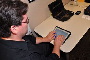 Mario Romero, one of BrailleTouch's co-inventors, demonstrates the app on a tablet.