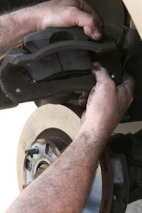 You may need a brake caliper tool to retract the caliper piston. This will provide the clearance you'll need to install the new brake pads.