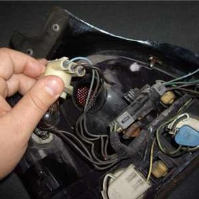 If you need to replace the socket, it's often easiest to simply cut the wires, then splice on the new socket.