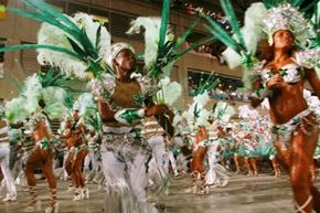 A samba school performs during the annual Carnival parade in Rio de Janeiro, Brazil. The 14 samba schools are the main attraction of Rio's Carnival, performing to approximately 70,000 spectators in a stadium built especially for the celebration.