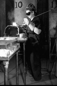 A woman brazing an automobile casting. She works at an aircraft factory and attends Burgard Vocational School at night to learn heavy welding. Buffalo, New York, April 1943.