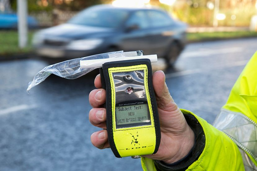 Police officer in Belfast, Northern Ireland, holds an operational breathalyzer