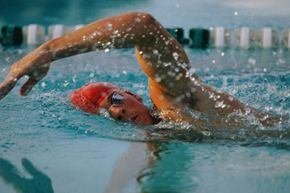 This freestyle swimmer turns his head to the side to breathe.