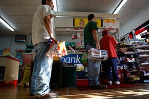 These Texas shoppers opt for beer and chips before Hurricane Ike. While that's more original than milk and bread, experts say you should go for canned goods and bottled water.