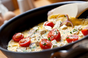 Eggs whipped up into a quick, veggie-filled omelet make an inexpensive and nutritious family dinner. See more easy weeknight meal pictures.