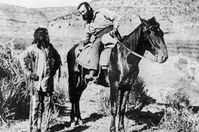 American anthropologist, geologist and explorer Major John Wesley Powell speaks with a Paiute Indian about the location of a water supply during a survey of Arizona in 1873.
