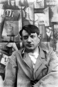 """Pablo Picasso poses with his canvas, """"The Aficionado,"""" in the summer of 1912."""