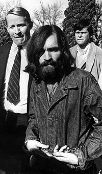 Manson being led from a courthouse in 1969
