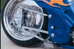 Unusual 4-link rear suspension of the Custom Shop Cycles Pro Street Chopper adds a hi-tech touch.