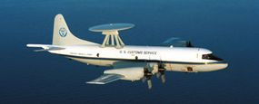 A P3 radar plane patrols the U.S. coast from above. When the plane's crew locates possible smugglers, it transmits the location to the central customs office.