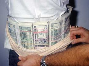 This man tried to smuggle more than $77,000 in drug money, concealed under his shirt with an elastic band.