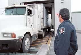 Customs inspectors use giant X-ray machines to search for contraband inside a truck.