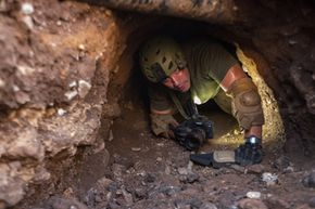 A Border Patrol agent inspects a man-made tunnel near Nogales, Ariz. Such tunnels are used to transport drugs under the U.S. border.