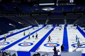 Teams in the Tim Hortons Brier in Edmonton, Alberta practice before the Canadian Men's Curling Championship. The spot inside the red circle is the tee. The house is anywhere inside the blue circle.