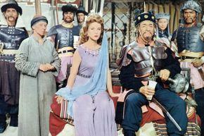 "Susan Hayward, John Wayne and assorted other actors in ""The Conqueror"""