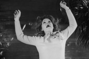 """Lee Remnick, who plays Katherine Thorn aka mom of the kid Antichrist, falls from a balcony in a scene from """"The Omen."""""""