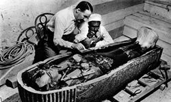 """Archaeologist Howard Carter and an assistant examine the coffin of Tutankhamen with little regard for the """"curse."""""""