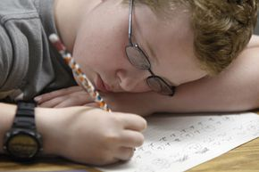 Third grade student Conner Everett learns cursive penmanship at school in 2012. Some people question whether cursive handwriting is a dying art form.