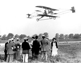 Early powered flight was a novelty that inevitably attracted onlookers, as in this circa 1910 scene of a graceful Golden Flyer.