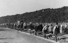 CWA workers on their way to fill a gully with wheelbarrows of earth during the construction of the Lake Merced Parkway Boulevard in San Francisco, 1934.