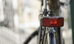 Many states require you to have a red light or reflector with at least 600 feet of visibility for the rear of your bike.
