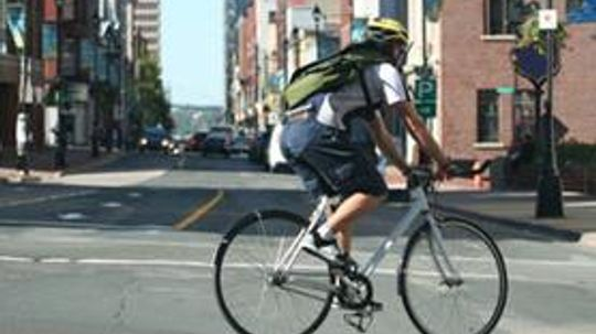 Cycling Tip of the Week: How to Change Lanes and Make Left Turns