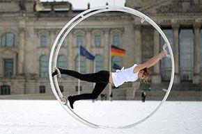A member of a Berlin wheel gymnastics team performs on the German wheel or Rhönrad in Berlin in 2013.