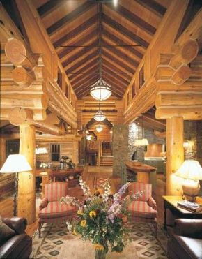 Quietly elegant armchairs and leather sofas civilize the massive logs used for the home's structure.