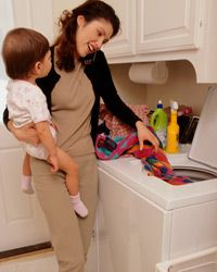 In addition to cabinets, a few other kitcheny concessions, like a hanging paper towel dispenser, could make your laundry life easier.