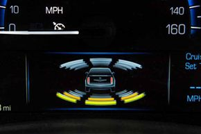 Cadillac's latest safety technologies include graphics on the gauge cluster that indicate when an object has been detected in the path of the vehicle.